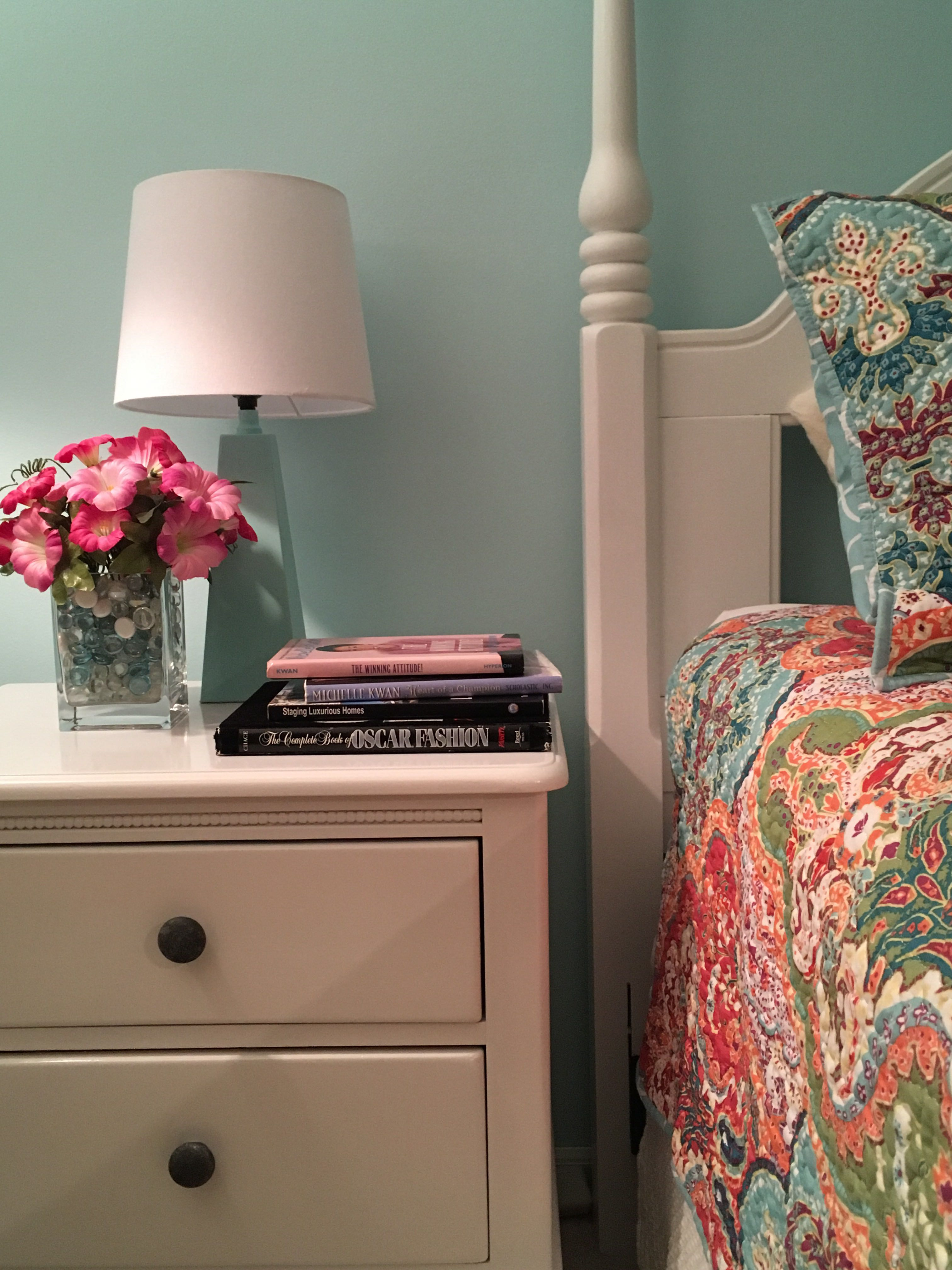 Showcasing a bedroom redesign with new furniture, paint, and indoor décor.